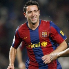 I'm a romantic, says Xavi, heartbeat of Barcelona and Spain